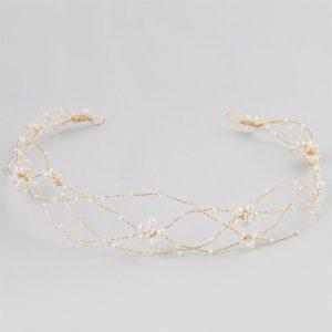 Accesorio ANHP29 dorado con aplicacion floral de perla